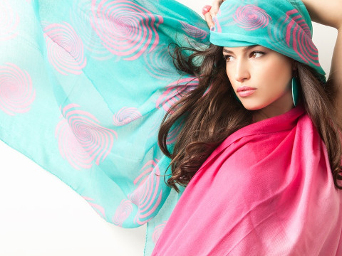 young beauty with blue pink scarf over her head, studio shot