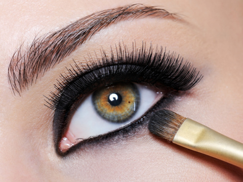 Bright black eye make-up on the close-up shot of female eye - long eyelashes